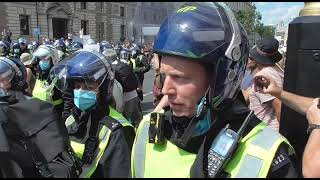Riot police block the road. the people cant get to downing street freedom day 21-7-2021